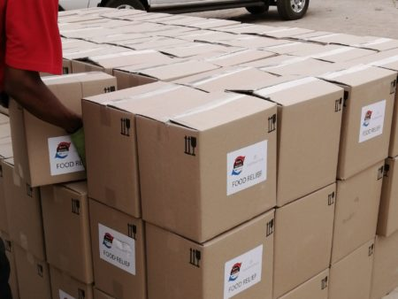 NISSAN AT DELIVERY OF FOOD PARCELS TO LOCAL COMMUNITY